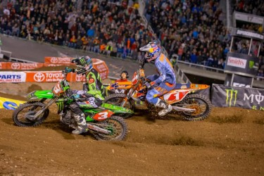 Tomac and Dungey are in a heated battle .